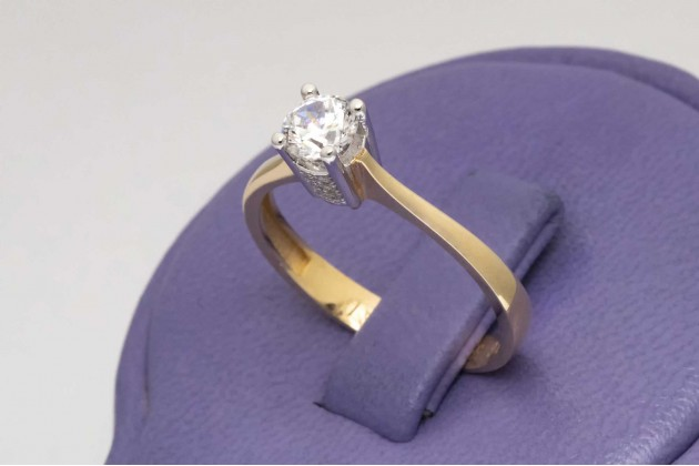 Classic yellow and white gold engagement ring with zircon
