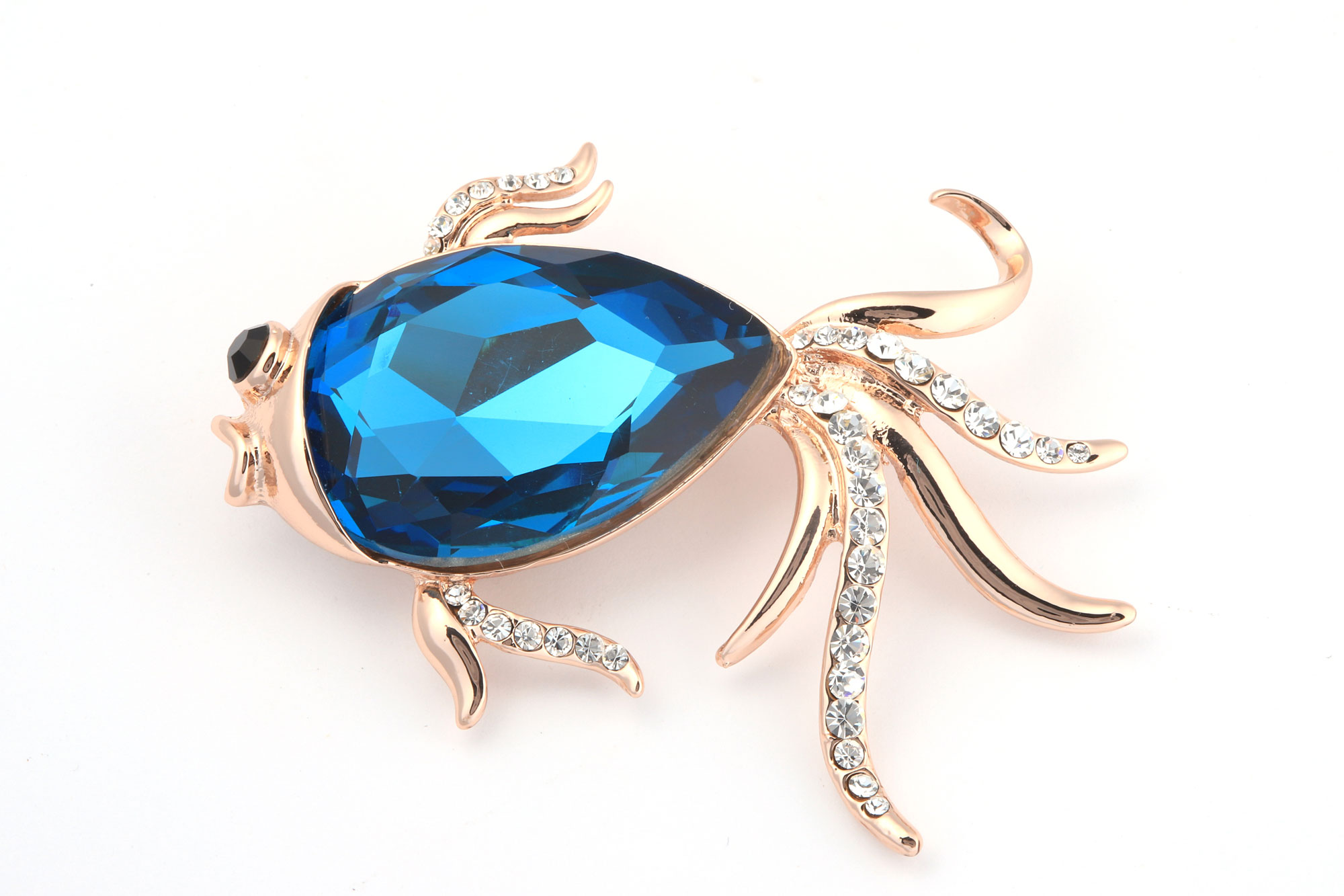 Брошка със сини кристали