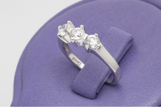 Delicate silver trinity ring with zircons
