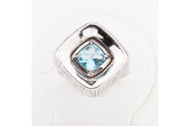 Beautiful silver ring with blue topaz